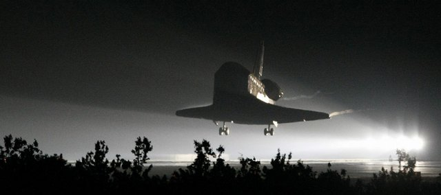 The space shuttle Endeavour lands Wednesday night at the Kennedy Space Center in Cape Canaveral, Fla. Weather delays during the day prompted the rare nighttime landing.