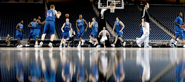 The Kansas Jayhawks run a weave to start off their first practice Thursday at Ford Field in Detroit. The team faces Villanova at 8:40 tonight in the Sweet 16 round of the NCAA Men's Basketball Tournament.