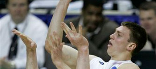 North Carolina's Tyler Hansbrough, right, shoots over Washington State's Aron Baynes during an NCAA East Regional basketball semifinal Thursday, March 27, 2008, in Charlotte, N.C.