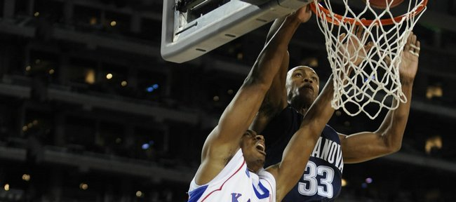 Kansas' Darrell Arthur (00) dunks on Villanova's Scottie Reynolds (1) and Dante Cunningham in the Jayhawks' 72-57 victory. The outcome Friday in Detroit lifted KU into the Elite Eight.