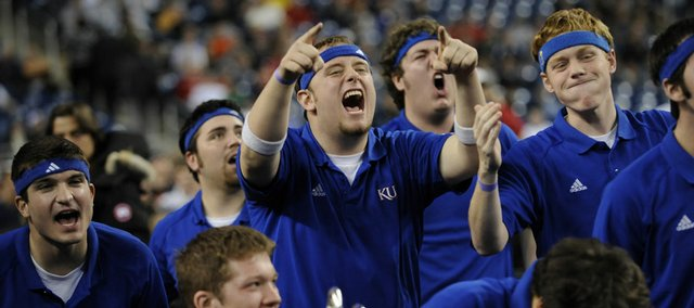Tyler Metzger, center, a Kansas junior from Oskaloosa, lets loose with other members of the Kansas Basketball Band in the second half of KU's Sweet 16 game against Villanova in the NCAA Tournament Friday in Detroit. The Jayhawks won 72-57.