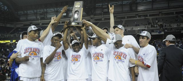 The Jayhawks hoist the Midwest Regional trophy following their victory over Davidson on Sunday in Detroit. Kansas is trying to become the first league school in the Big 12 era to win a national championship.