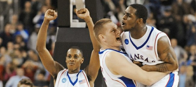 Kansas center Cole Aldrich hugs Sherron Collins as Mario Chalmers (15) hoists his fists as the buzzer sounds, signaling the Jayhawks' 59-57 victory over Davidson. Aldrich and Chalmers will face each other tonight in an NBA exhibition game at the Sprint Center.