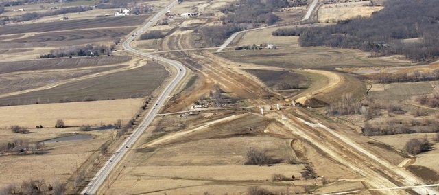 Construction work on a new U.S. Highway 59, seen at right, is taking shape next to the current highway, seen at left, just north of Ottawa. A wet winter has slowed progress, but it is still expected to finish on schedule in 2011.