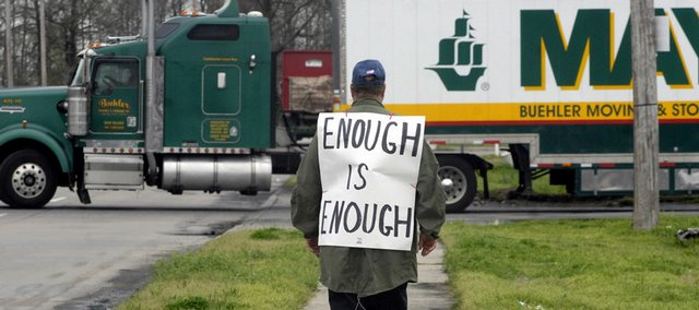 Jack George, an independent trucker, pickets outside a truck stop in Little Rock, Ark. Truckers across the country on Tuesday protested the high cost of diesel fuel.