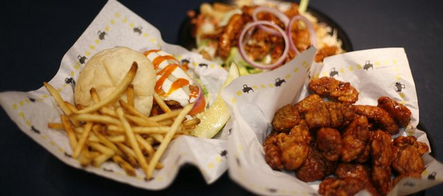 Hot wings and chicken-topped salads with sides of fries are among the popular foods served to NCAA Tournament game-watchers at Buffalo Wild Wings Bar & Grill, 1012 Mass.