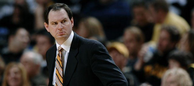 After two years as Oklahoma State's coach, Sean Sutton, right, resigned under pressure Tuesday, setting off speculation that OSU might try to hire Oklahoma State grad Bill Self away from KU.