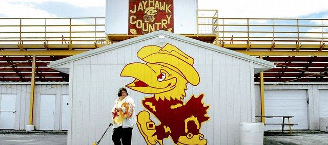 Cecilia Gunn, assistant coach for the girls track team at Jayhawk-Linn High School, gets ready to mark the school's track Monday. The Mound City school is among about nine other schools across the country that use a Jayhawk as their mascots.
