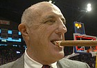 Kansas athletic director Lew Perkins chews on a cigar after the KU men's basketball team beat Texas in this file photo from March 3, 2007, at Allen Fieldhouse.