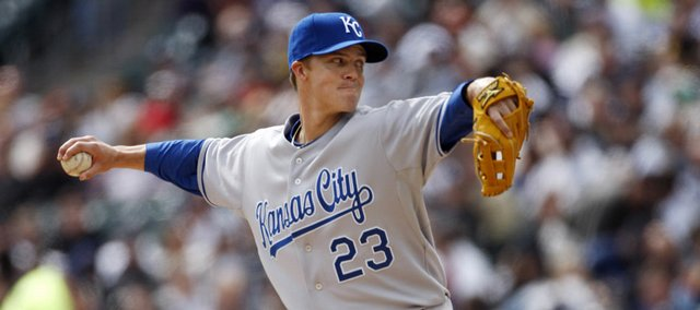 Kansas City Royals starter Zack Greinke delivers against Detroit in the fifth inning. The Royals defeated the Tigers, 4-1, Thursday in Detroit to remain unbeaten.