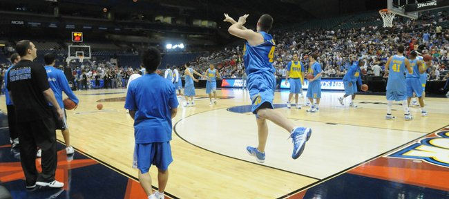 UCLA center Kevin Love hoists a full-court shot. Love and the Bruins entertained the crowd Friday in San Antonio.