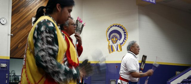 From left, Brady LaCour, of Carnegie, Okla., Steve LaCour Sr., of Lawrence, and Timothy Tieyah, of Medicine Park, Okla., perform a gourd dance Saturday at the Indigenous Empowerment Summit at Haskell Indian Nations University.