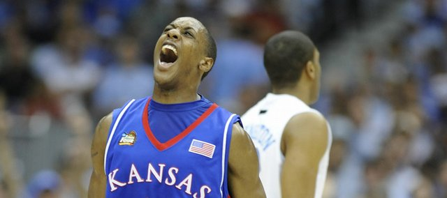 Kansas' Mario Chalmers screams with jubilation after draining a three against North Carolina in the first half of the 2008 Final Four game.