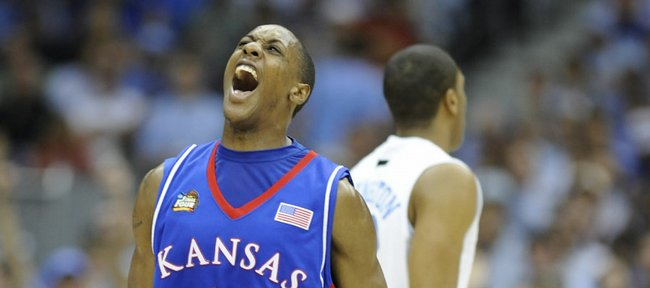 Kansas&#39; Mario Chalmers screams with jubilation after draining a three against North Carolina in the first half of the 2008 Final Four game.