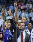 Kansas coach Bill Self and his players signal victory to a national audience Saturday after defeating North Carolina in the Final Four at the Alamodome in San Antonio.