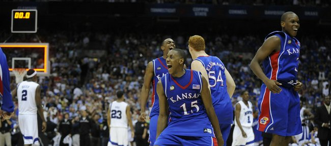 Kansas University's Mario Chalmers (15) leads the celebration as time runs out on the Jayhawks' 75-68 overtime victory over Memphis. Chalmers hit a three-pointer to tie it with 2.1 seconds left in regulation, and the Jayhawks went on to win their first national title in 20 years.