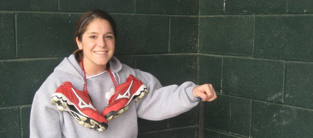 Lawrence High second baseman Kalli McClure is one of several local softball players who have chosen to stick with rubber cleats instead of switching to metal cleats, now allowed by the Kansas State High School Activities Association.