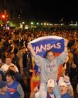 Fans celebrate on Mass. St. after the Jayhawks' 75-68 overtime win over Memphis in the final game of the 2008 NCAA Men's Basketball championships.  KU's National Champion basketball team will be honored on Sunday at a 3 p.m. parade that will run along Massachusetts Street from Seventh Street to South Park.