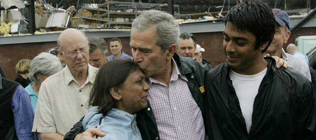 President Bush comforts residents in the aftermath of the May 2007 tornado in Greensburg. Bush is going to speak at the high school's commencement on May 4.
