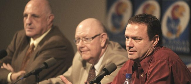 Kansas coach Bill Self, right, speaks at a news conference Thursday at Hadl Auditorium about his intentions to stay with the Jayhawks. An agreement on a new contract has been made in principle, though the details of Self's extension haven't been announced. At middle is Kansas University Chancellor Robert Hemenway, and at left is KU athletic director Lew Perkins.