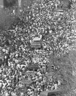 Some 60,000 people pack Massachusetts Street in downtown Lawrence to celebrate Kansas University's 1988 Men's NCAA Basketball Championship. For Sunday's parade - a celebration of the 2008 title -organizers are expecting up to 100,000 people, and the parade route has consequently been extended southward on Massachusetts Street all the way to 19th Street, then westward to Naismith Drive.