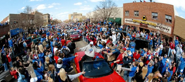 An estimated 80,000 Jayhawk fans line Massachusetts Street to greet the Kansas University men's basketball team, the 2008 national champions, including player Darrell Arthur, during a parade Sunday. The team also gathered for an awards ceremony Sunday afternoon at Allen Fieldhouse.