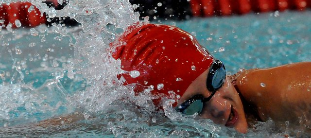 Lawrence High's Erina Houk cuts through the water in the 200 freestyle. Houk took third in the event, and LHS won the meet Tuesday at Knox Natatorium.