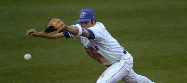 Kansas University's Erik Morrison leaps for a ball but comes up empty. KU edged Missouri State on Wednesday at Hoglund Ballpark.