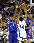 Kansas defenders Darrell Arthur, left, and Brandon Rush double-team Memphis guard Chris Douglas-Roberts in the 2008 NCAA Championship game.  On Thursday Arthur and Rush declared for the 2008 NBA draft.