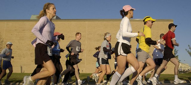 Participants of the half marathon make their way towards 23rd Street in this file photo.