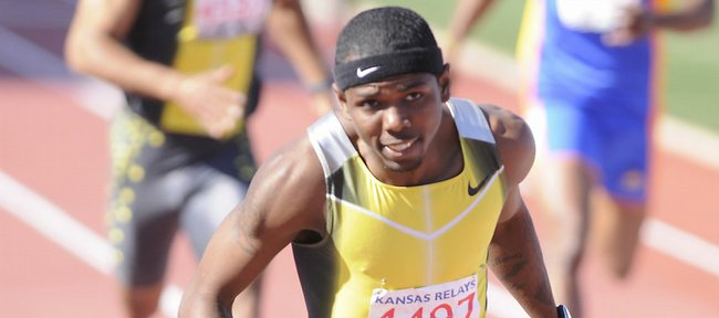 """Bershawn """"Batman"""" Jackson decelerates after winning the 400-meter hurdles. Jackson notched the fastest outdoor time in the world this season at 48.32."""