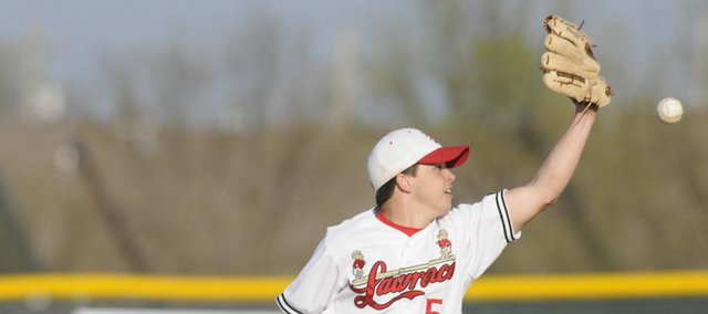Lawrence High second baseman Devin Forio misses a throw. The Lions committed six errors in a 6-3 loss to Shawnee Mission West on Tuesday at Ice Field.