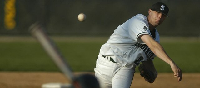 Free State senior Kelson Boyer delivers a pitch. Boyer, a transfer from Eudora, led the Firebirds to an 8-3 victory against Shawnee Mission South on Tuesday at Free State.