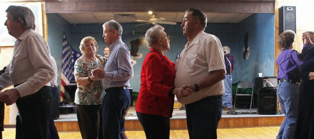 "Patsy Ford and Lyle Maddux, left, dance by Phyllis Hubbard and Howard Graham, center, during the Sunday night dance organized by Oldsters United for Responsible Service (OURS) at the Eagles Lodge, 1803 W. Sixth St. The crowds have nearly doubled since the dances were moved from the Lawrence Senior Center in January. Ford and Maddux have come off and on to the dances for years. ""It's like everyone's a friend now,"" Ford said."