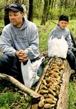 Joe Thomas and his son Joseph, from St. Joseph, Mo., show off the morels they collected in an hour and a half along the Kansas River northeast of Lawrence. The Thomases spent Sunday morning hunting in an area where Joe learned from a relative how to find the tasty treat.