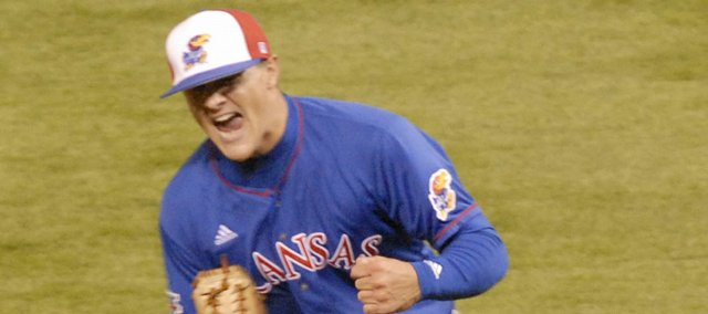KU pitcher Shaeffer Hall pumps his fist and celebrates a strikeout to end the seventh inning.
