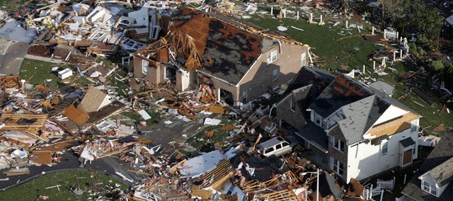 Residents picked up the pieces Tuesday after a tornado leveled homes in Suffolk, Va. Six tornadoes in the state injured more than 200 residents Monday but caused no deaths.