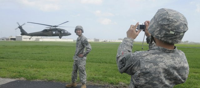 Jason Cha, 19, a freshman from Shawnee, joins other Kansas University ROTC students spending Thursday afternoon at the Lawrence Municipal Airport. The expedition taught them about the Blackhawk helicopter, with a unit from Topeka helping to take students on a short ride. A friend shot a picture of Cha and a Blackhawk taking off.
