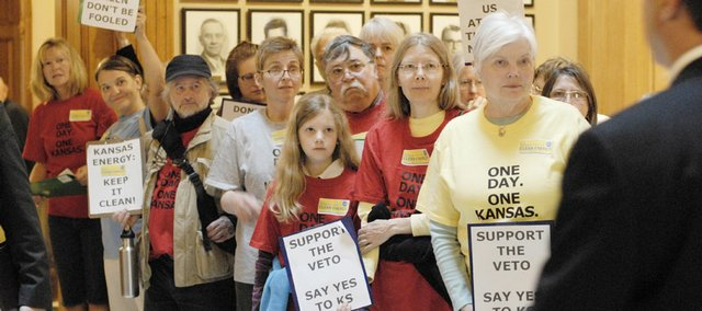 Coal-plant opponents line the corridors of the Kansas Capitol as representatives make their way into the House Chambers on Wednesday in Topeka. Gov. Kathleen Sebelius rejected an alternative proposal for a coal-fired electric plant project, forcing an attempt to override Sebelius' April 17 veto of a second bill allowing the plants in southwest Kansas. Today the House failed to override the veto by four votes.