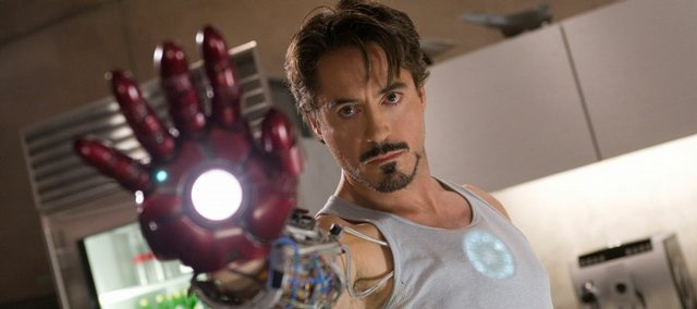 "Robert Downey Jr. tests out his armor in the superhero adventure ""Iron Man."""