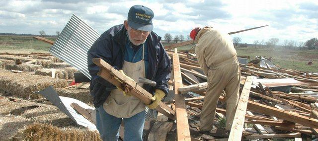 Volunteers help clean up storm damage to Pendleton&#39;s Country Market in this March 13, 2006, file photo. Spring is a key time for volatile weather, and aspiring photographers can capture strong images by packing a variety of cameras and lenses, if available.