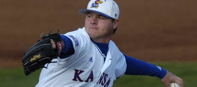 Kansas University pitcher Nick Czyz delivers during the Jayhawks' 17-15 victory over Oklahoma. The Jayhawks outslugged the Sooners on Friday at breezy Hoglund Ballpark.