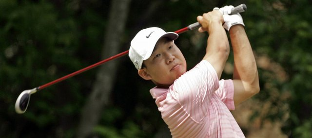 Anthony Kim watches his tee shot on the fifth hole. Kim fired a 6-under 66 in the Wachovia Championship on Saturday in Charlotte, N.C.