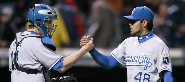 Kansas City pitcher Joakim Soria, right, celebrates with catcher John Buck after the Royals beat Cleveland, 4-2. Soria earned his seventh save Saturday in Cleveland.