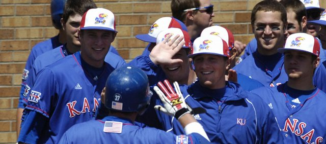 The KU baseball team congratulates Robby Price on his homerun Saturday, May 3, 2008 during the Jayhawks' home game against Oklahoma. KU won the game 13-10.