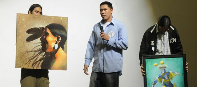 Orlando Begay, center, a Navajo tribe member and junior at Haskell Indian Nations University, talks about some of his artwork during the modern talent presentation of the Miss Haskell and Haskell Brave 2008-2009 competition. Begay is the sole candidate for Haskell Brave.