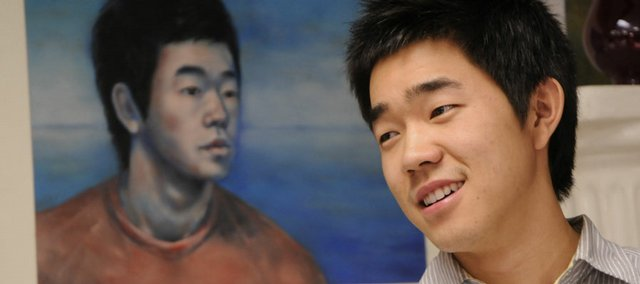 Lawrence High School senior Alex Kim's self-portrait was honored in the Congressional Art Competition. U.S. Rep. Nancy Boyda presented Kim with a certificate Monday. It was the second time Kim's work has been recognized in the competition.