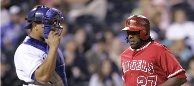 Los Angeles Angels' Vladimir Guerrero, right, runs past Kansas City catcher Miguel Olivo. Guerrero scored twice in the Angels' 5-3 victory Tuesday in Kansas City, Mo.
