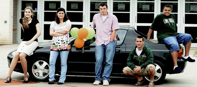 Seniors from each Lawrence high school will be eligible to win a 1994 Honda del Sol by attending the Project Graduation party May 25. Representing their schools are, from left, seniors Erika O'Shea, Bishop Seabury Academy; Marie Fattaahi and Isaiah Dover, Veritas Christian School; Taylor Bussinger, Lawrence High; and Tristan Willits, Free State.