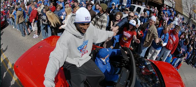 Kansas&#39; Darrell Arthur greets thousands of fans during a parade for the National Champion Jayhawks on Sunday, April 13, 2008 in downtown Lawrence, Kan.